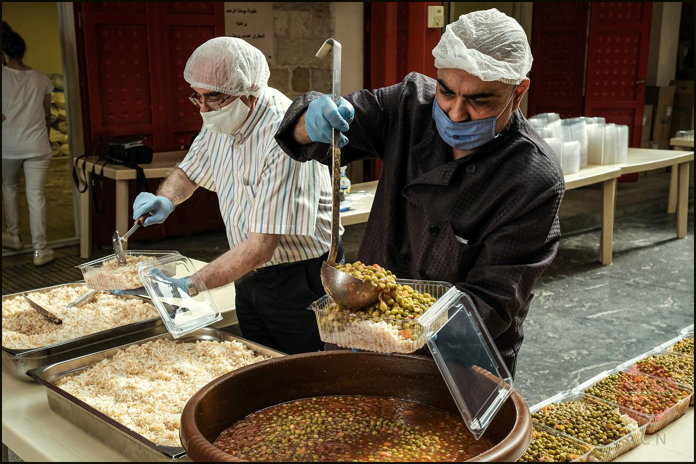 Reparto de comida en el comedor San Juan Misericordioso. (ACN)